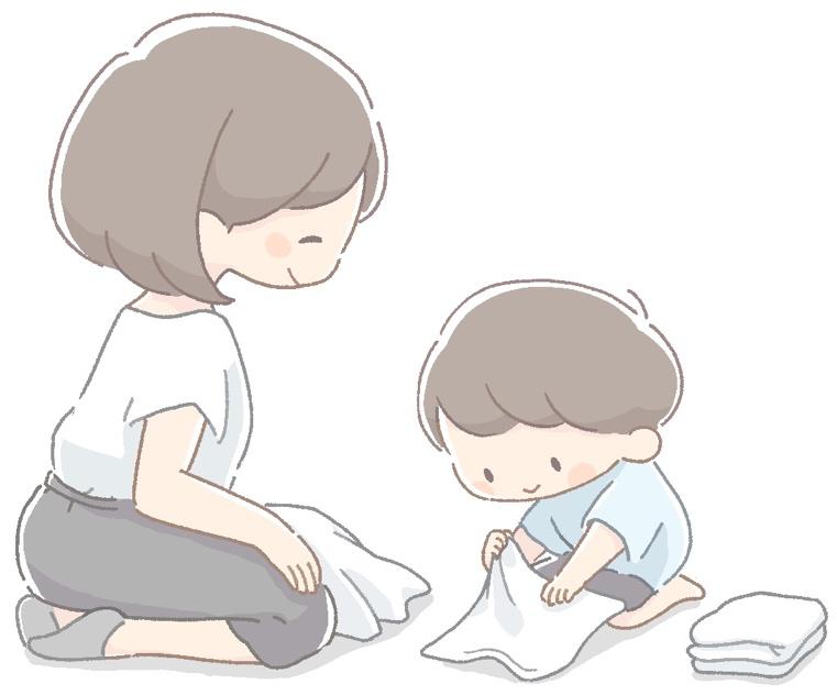 洗濯物を一緒にたたむ親子