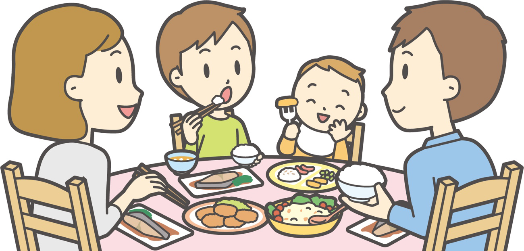 家族で夕食を食べる様子