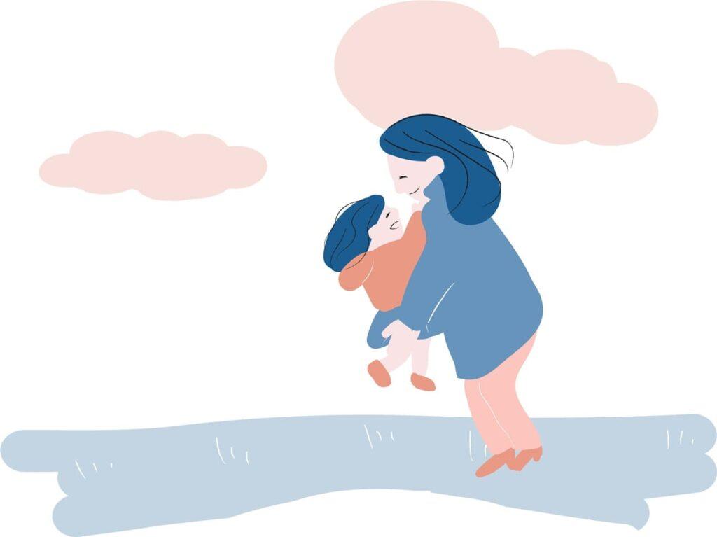子どもを抱っこする母親